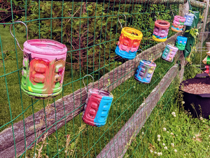 Fence Herb Planters Connected to Wire Split Rail Fence, Painted Gatorade Bottle Flower Pots