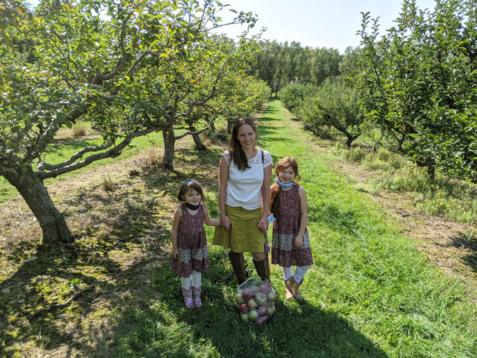Mom and Two Daughters at Pick-Your-Own Apples Orchard