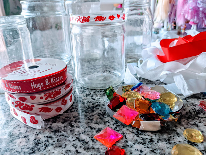 Reusing Old Candle Jars in Kids Crafts - Valentine's Day Vase for Flowers - Supplies of Valentine Ribbon, Rhinestones, and Empty Glass Jars