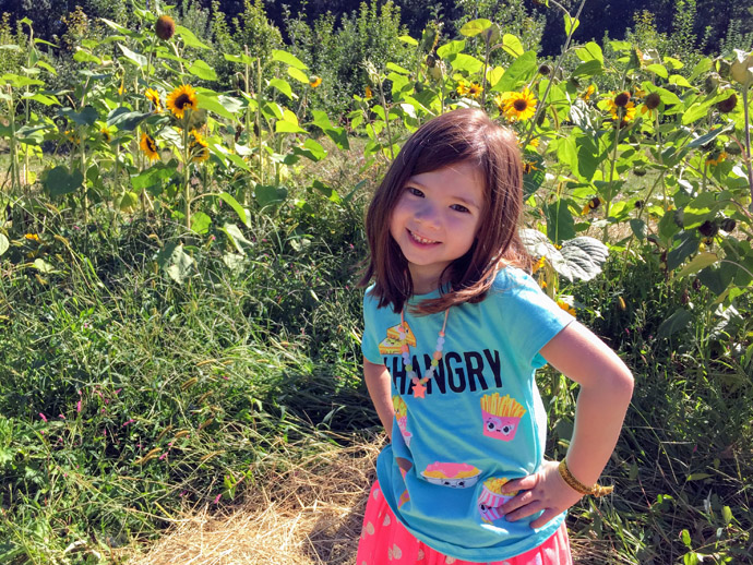 Daughter in a cut-your-own Sunflower Field