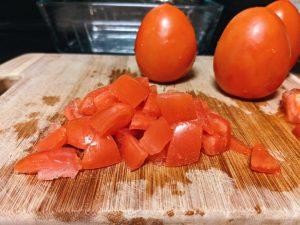 Dice Roma Tomatoes on Cutting Board