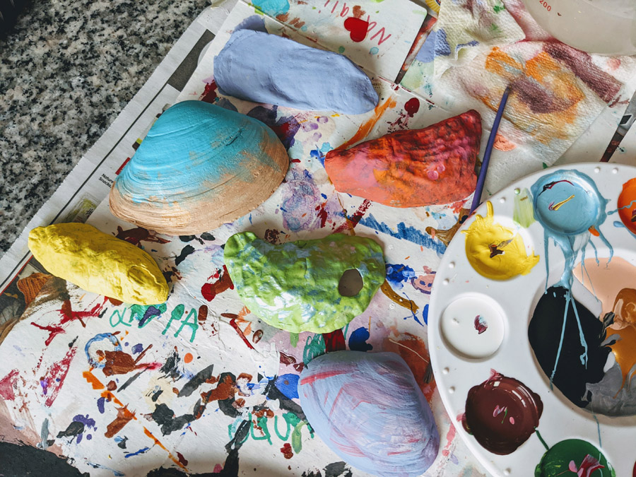 Painting Seashells with Acrylic Paint for Outdoor Garden Markers - Shells and Paint Palette on Table with Newspaper