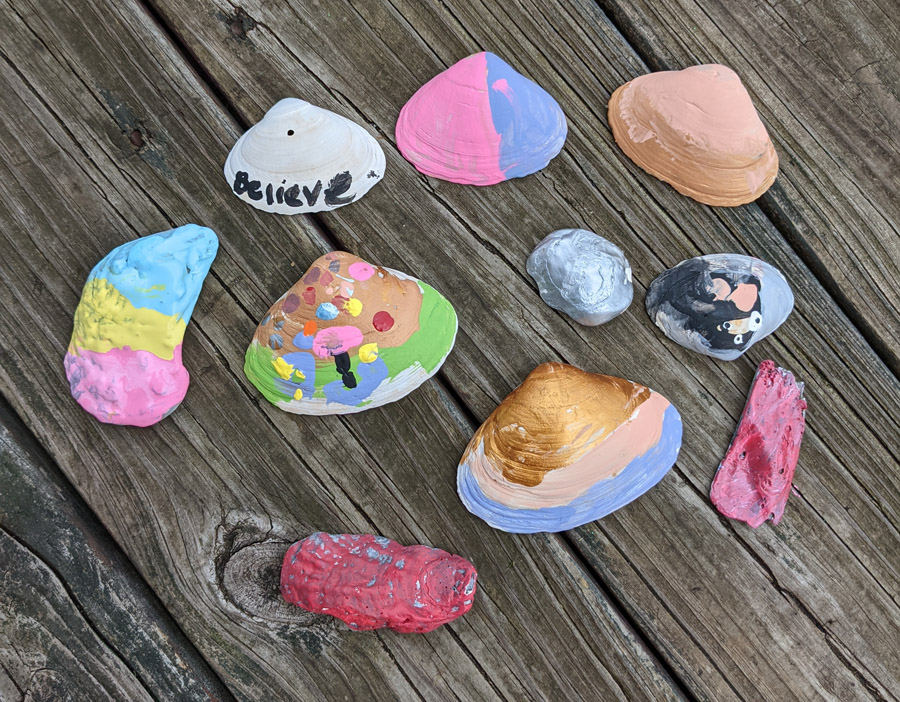 DIY Kids Gardening Craft - Shell Garden Markers in lots of pretty colors on a wooden deck