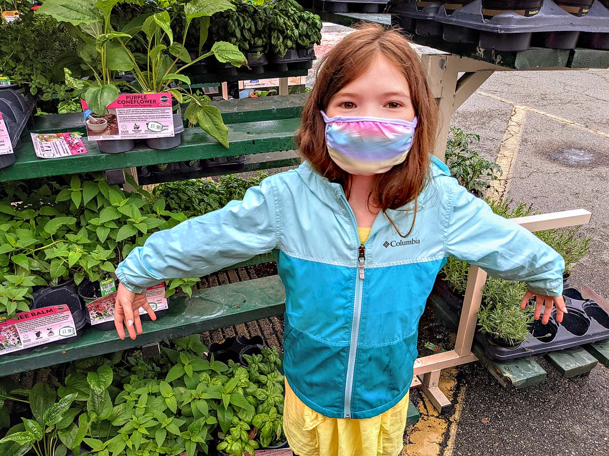 Daughter posing as a plant at Lowes