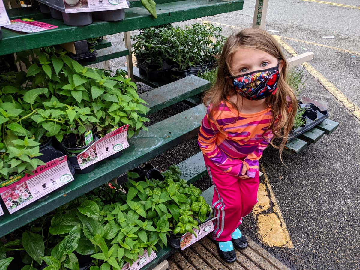 Daughter with herbs for sale at Lowes