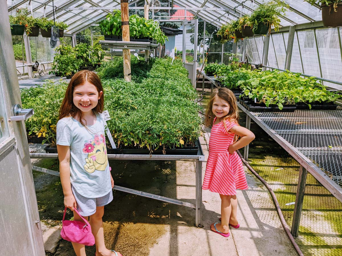 Girls in the Greenhouse - I wish we had one of our own!