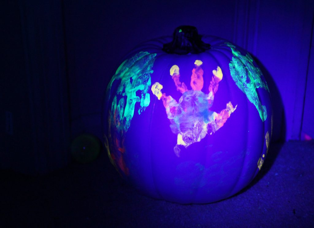 Cute Paintings on Pumpkin of Glowing Halloween Handprints by Kids